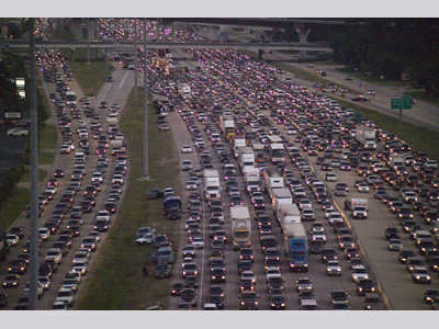 Thousands of cars jammed up on a highway